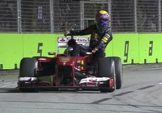 Alonso giving Webber a ride back to the pits after the 2013 Singapore Grand Prix