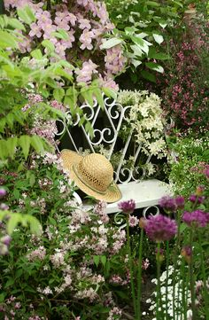 Straw hat on a garden bench