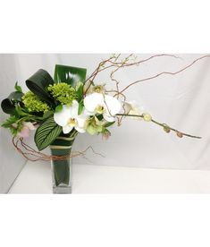Signature Floral Design by Eliana Nunes Floral Design | Winston Salem NC Florist | Monochromatic Floral Arrangement | Ochirds, Hydrangeas, Leaf Work, Curly willow, Hellebores