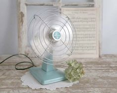 Vintage 1950s Eskimo fan in a popular teal or aqua color. This fan works great! I have cleaned it up and even oiled it a bit. These fans back