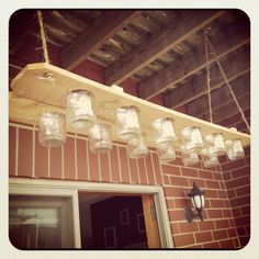 Mason Jar Chandelier by UltimateDIYGuy on Etsy, $50.00.  Ok I love the for the guys section.  This is a keeper!