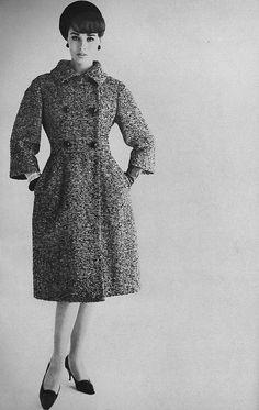 Sondra Peterson wearing a coat by Ben Zuckerman. Vogue, August 1961.