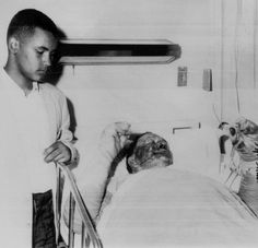 AP Dennis Dahmer, 12, stands by his dad Vernon Dahmer, 58, a civil rights leader who was burned when KKK nightriders set fire to his home and store. He died in a Hattiesburg, Miss., hospital 11 hours after he was injured on Jan. 10, 1966.