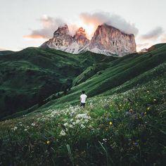 Merlin Kafka | broad landscape | distant mountains | open fields | evening sunset illuminating horizon