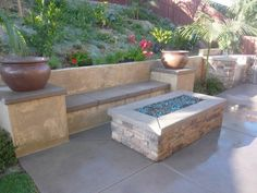 What more can you ask for - rectangular fire pit, built in bench seating and planters on top of pillars! Quality Living Landscapes San Marcos, CA