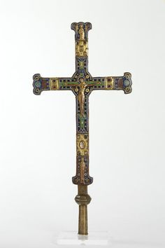 Cross Limoges, France (made)  Date: ca. 1250 (made)  Artist/Maker: Unknown (production)  Materials and Techniques: Champlevé enamel on copper, in combination with copper-gilt plaques