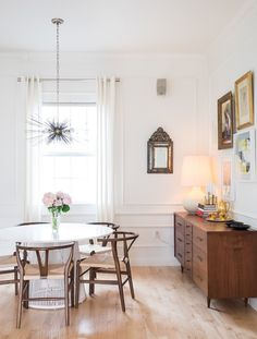 The simple and inexpensive addition of moldings and Victorian-style paneling throughout the living and dining areas adds a sense of grandeur to the space.