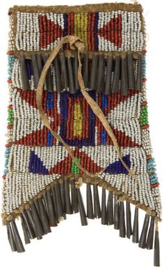 American Indian Art:Beadwork and Quillwork, A SIOUX BEADED HIDE STRIKE-A-LIGHT POUCH. c. 1890...