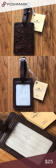 "Patricia Nash Italian leather luggage tag Travel in style with this gorgeous Italian leather luggage tag from Patricia Nash. Refined yet rugged in a richly tooled design, it adds a chic touch to every piece of luggage. Italian leather Adjustable 3"" strap with buckle closure Exterior features clear information slot, signature antiqued brass hardware and heavy hand stitching 2-7/8"" W x 7-1/4"" H x 1/8"" D Patricia Nash Bags Travel Bags"
