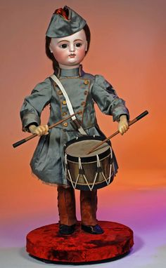 French bisque automaton drummer by Roullet & Decamps, all original, circa 1900, head turns side-to-side as it beats the drum, 28 inches, Estimate: $6,000-$9,000. Image courtesy of Frasher's Doll Auction.