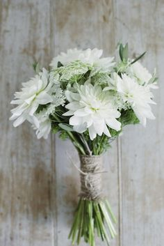 All-white rustic chic bridesmaid bouquets - white dahlias + Queen Anne's lace tied with burlap and twine {Photo by Basia}
