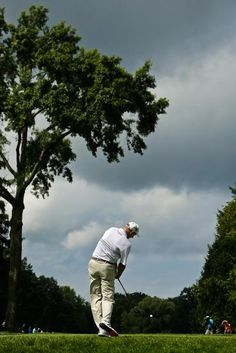 Jim Furyk hits his tee shot on the seventh hole during the second round of the PGA Championship at Oak Hill Country Club, on Friday in Pittsford, N.Y. (Charles Riedel/AP)