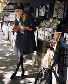 Secondhand bookseller, along on the Seine river - I've shopped at these before, but unfortunately I never look that glamorous.