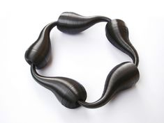 Polypropylene tape wrapped and twisted into shapes somehow become jewelry – Cocoons – one of several collections from Lucie Houdková.