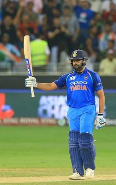 Indian cricket captain Rohit Sharma celebrates after scoring 50 runs during the cricket match of Asia Cup 2018 between India and Pakistan at. India Cricket Team, Cricket Sport, Cricket Match, Ab De Villiers Photo, Asia Cup 2018, Mumbai Indians Ipl, Ms Dhoni Wallpapers, Ms Dhoni Photos, Cricket Wallpapers