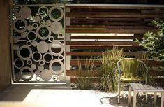 Garden ideas fence metal circular horizontal lines wood