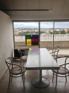 Le Corbusier Studio Apartment Paris. Marble tabletop, trumpet-bell bases, Thonet chairs.