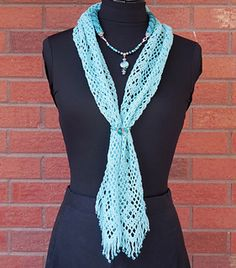 Aqua Beaded Bliss Scarf - This beautiful scarf combines the look of a beaded necklace with a lacy scarf, which can be worn in many ways! The beaded rope, created using a simple pattern of slip stitch bead crochet, is crocheted directly onto the ends of the scarf. A beaded connector, with clasps on each end, joins the two sides of the scarf. This is one of four patterns included in the Beaded Bliss pattern set.