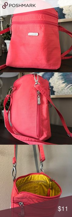 Baggalini messenger/Crossbody bag In very good condition, lightweight Baggalini bag.  Strap connects on one side for easier access.  Front hardware with Baggalini name scratches. Baggallini Bags Crossbody Bags