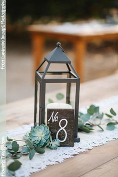 Lantern and Succulent Centerpiece | Flower by Third Bloom | Photo by Iluminaire Images