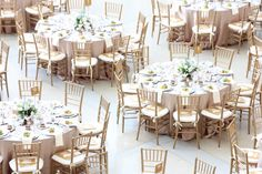 Opting for neutral tones for table cloth, napkin, and chairs helps create a more open, light, and airy feel to any reception space. This Indiana State Museum event special ordered the chiavari chairs, pictured, finishing off the look of the table.