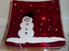 Large snowman on Ruby Platter Approximately thirteen by thirteen inches