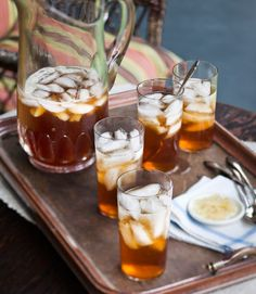 Ginger Iced Tea recipe  •1 1/4 cup(s) sugar   • 1/2 cup(s) thinly sliced fresh ginger   •2 1/2 quart(s) fresh brewed tea, such as Pu-erh or Kusmi St. Petersburg   •1 bottle(s) (750-milliliter) moscato, such as La Spinetta Bricco Quaglia   •12 slice(s) candied ginger, optional   • Ice cubes   IN RECIPE SEARCH ENGINE  put Ginger Iced Tea and the recipe should come up.