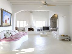 myconos style - love the fireplace and fan and the white!!