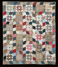 vintage Monkey Wrench Quilt  (churn dash) circa 1890 at The Quilt Complex.  Wonky sashing lends a modern look.