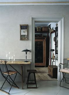 Vintage bistro chairs and stool, mirrors, the trunk ...all of these pieces are fabulous...