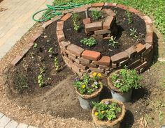Spiral brick raised herb garden bed.  Really want to find space in my yard to try this!