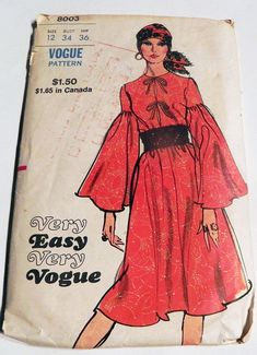Very Easy Very Vogue 8003; ca. 1971; Loosely fitted, A-line dress with jewel neckline has front opening with self ties and invisible zipper closing front seam. Full length sleeves are gathered to upper sleeve. Purchased belt holds in fullness at waist. Size 12 Bust 34 Waist 25.5