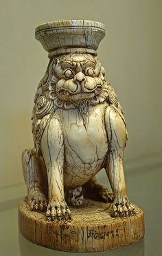 Ivory seated lion. Carved stand of ivory,from the Choskor Gyanntse monastery,Tibet,13th cent.  AD