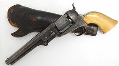 Colt 1851 Navy factory engraved revolver with Hartford barrel address and ivory grips.