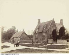OP01787. Houses in the village of Hinton In The Hedges, Northamptonshire. Photographer: Alice Marcon. For more information or to search our collections click on image. Female Photographers, Hedges, Alice, England, Cabin, Collections, House Styles, Search, Image