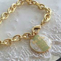 """Coach Heritage Lt Green Stripe Bracelet 100% Guaranteed Authentic Coach Heritage Lt Green Stripe charm on AUTHENTIC Coach chain designed into a 7.5"""" bracelet. No box.  I can adjust to ANY size needed.  Follow me so you can be notified of new items listed!  Take a peek at my other listings for more treasures... Coach Jewelry Bracelets"""
