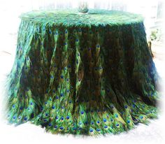 Handmade peacock feather table cloth, meant as a wedding accessory. -- Incredibly expensive, but totally breathtaking!