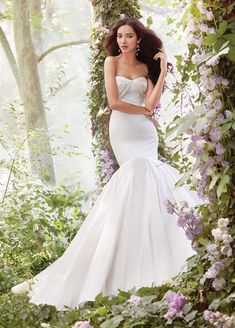 Ivory Silky Taffeta Fit and Flare bridal gown, elongated bodice with strapless draped sweetheart neckline, sweep train.