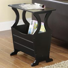 Decorate your living room with this Astara black magazine end table. Constructed from solid Asian rubberwood, this table provides additional storage space for magazines and books.