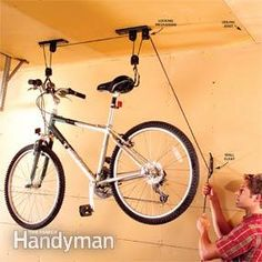 A great pulley system for storing the bikes from the ceiling. We use crank style boat winches from old boat trailers to store the small sailboat and bikes in the rafters of the haybarn. During hunting season we can easily haul up the 250lb deer we regularly take off the farm. to dress them out.