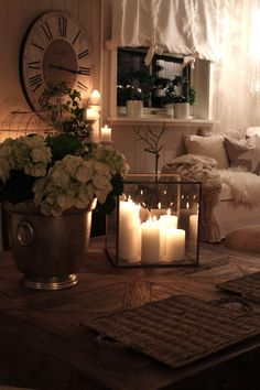 cozy, this is a different shot of a room I've posted before/ look for the glass candle holder on the coffee table.