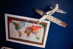 Alayna's Nursery Tour - Deep colors, bright patterns and vintage travel theme.  Vintage map and airplane.