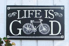 Hey, I found this really awesome Etsy listing at http://www.etsy.com/listing/108658377/1918-antique-bicycle-life-is-good-wood: