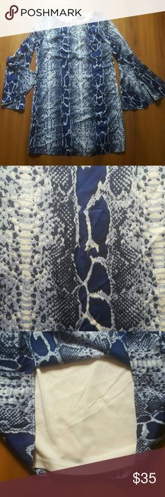 Snakeskin print mini dress with bell sleeves Gorgeous.  Worn three times.  Inside lined.  Cool opened back Aakaa Dresses Mini