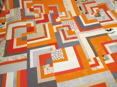 Mrs. Schmenkman Quilts and orange and gray it is.