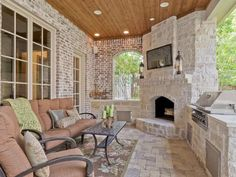 Love this porch with the stone fireplace & outdoor grill