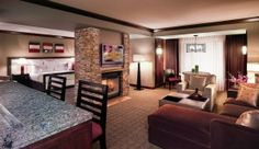 Spa Suite with Jacuzzi tub, fireplace, bar and seating area. Ameristar Casino Resort Spa in Black Hawk, Colorado.