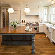 Chic farmhouse kitchen like the dark blue grey island