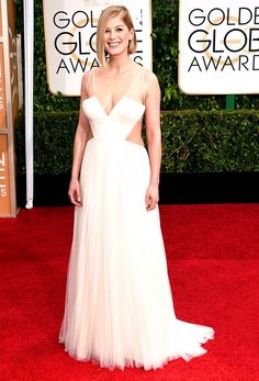 Rosamund Pike wearing a Vera Wang ivory V-neck hand draped silk tulle gown at the 72nd Annual Golden Globes