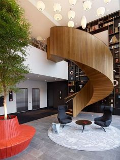 sculptural wood paneled circular stair | Ultralinx